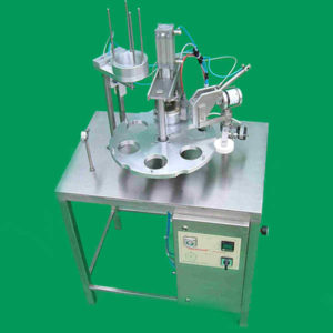 Semi automatic rotary cup filler