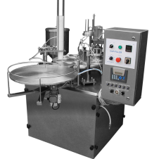 Cup filling and closing machine
